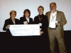 Board members presenting check to SPE